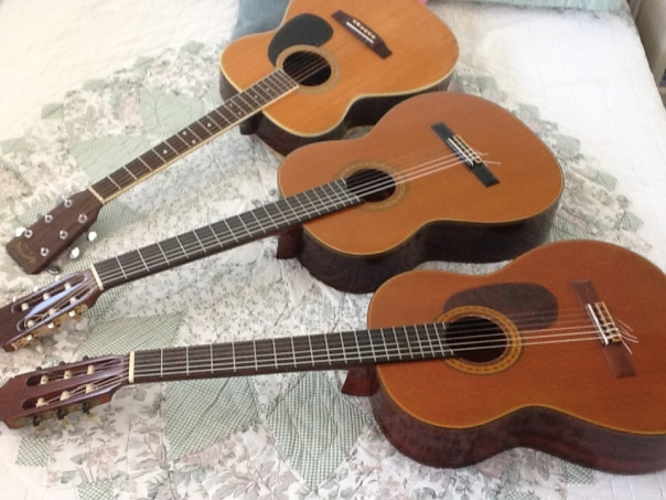 Lawsuit Takamine F310S on top; Takamine C132S Classical; Epiphone EC25 Espana folk guitar, bottom