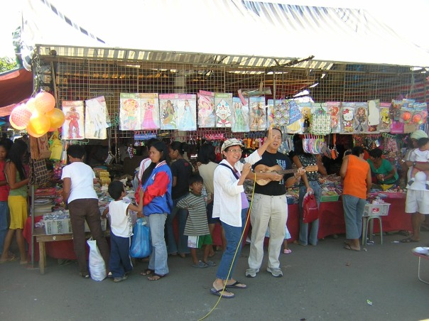 Marketplace preaching is still safe in some small towns in the Philippines.  That's me preaching in Pozorubio, Philippines.