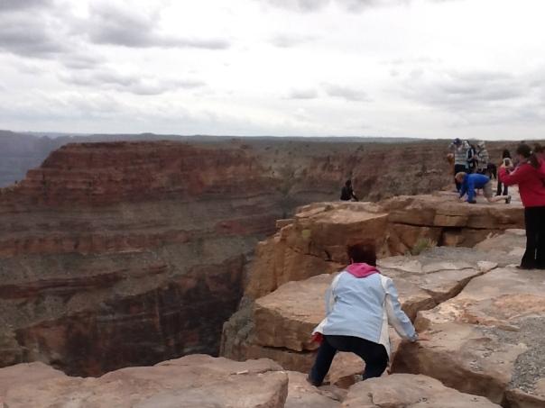 An agile senior citizen clamors over the rocks!